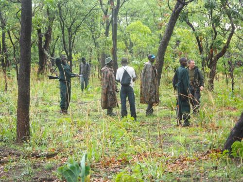 Village game scouts patrolling during rainy season